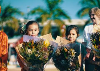 Children holding flowers